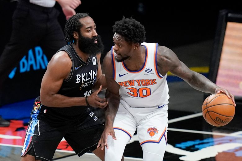 Brooklyn Nets' James Harden, left, defends New York Knicks' Julius Randle during the first half of an NBA basketball game Monday, April 5, 2021, in New York. (AP Photo/Frank Franklin II)