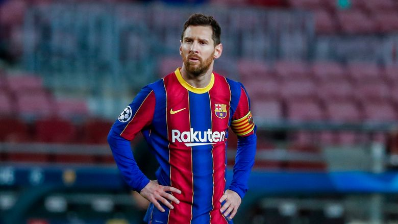 """FILE – In this Tuesday, Feb. 16, 2021 file photo, Barcelona's Lionel Messi looks on during their Champions League soccer match against Paris Saint-Germain at the Camp Nou stadium in Barcelona, Spain. Messi is set to play his 45th """"clasico"""" match against Real Madrid on Saturday, April 10 and it could be his last. Messi has said he will decide his future when his contract expires at the end of the season. (AP Photo/Joan Monfort, file)"""