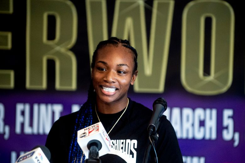 FILE – Boxers Claressa Shields speaks during a news conference ahead of a women's super welterweight title fight against Eve Dicaire in Flint, Mich., in this Wednesday, March 3, 2021, file photo. Two-time Olympic boxing gold medalist Claressa Shields has a date and an opponent for her mixed martial arts debut with the Professional Fighters League. Shields will fight Brittney Elkin on June 10, the promotion told The Associated Press on Wednesday, April 14, 2021. (Jake May/The Flint Journal via AP, File)