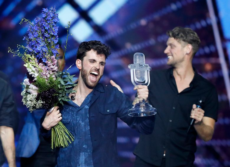 FILE – In this Saturday, May 18, 2019 file photo, Duncan Laurence of the Netherlands celebrates after winning the 2019 Eurovision Song Contest grand final in Tel Aviv, Israel. Organizers of the 2021 Eurovision Song Contest have welcomed the news that up to 3,500 fans may be allowed to attend the popular music competition when it is staged in the Netherlands in May 2021. The Dutch government has said it plans to make the annual contest of singers representing their countries part of a series of test events it is using to evaluate how to safely reopen large-scale public events amid the coronavirus pandemic. (AP Photo/Sebastian Scheiner, File)