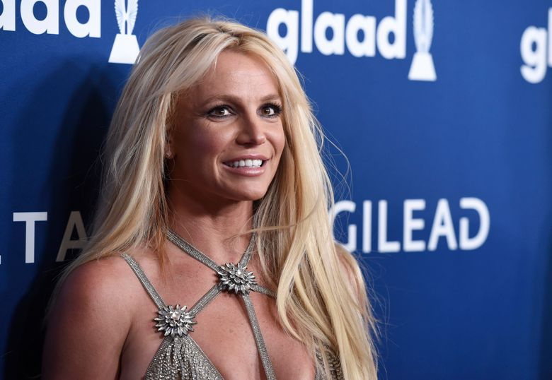 FILE – Britney Spears arrives at the 29th annual GLAAD Media Awards on April 12, 2018, in Beverly Hills, Calif. Spears has asked to address the court to talk about the conservatorship that controls her life and finances. A Los Angeles judge on Tuesday, April 27, 2021, set a June hearing to hear from Spears. (Photo by Chris Pizzello/Invision/AP, File)