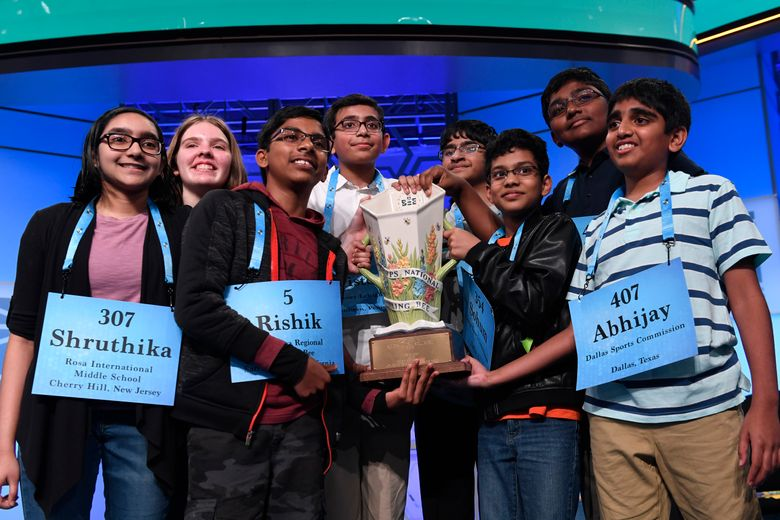 FILE – In this Friday, May 31, 2019 file photo,T he eight co-champions of the 2019 Scripps National Spelling Bee, from left, Shruthika Padhy, 13, of Cherry Hill, N.J., Erin Howard, 14, of Huntsville, Ala., Rishik Gandhasri, 13, of San Jose, Calif., Christopher Serrao, 13, of Whitehouse Station, N.J., Saketh Sundar, 13, of Clarksville, Md., Sohum Sukhatankar, 13, of Dallas, Texas, Rohan Raja, 13, of Irving, Texas, and Abhijay Kodali, 12, of Flower Mound, Texas, hold the trophy at the end of the competition in Oxon Hill, Md. The Scripps National Spelling Bee is undergoing a major overhaul to ensure it can identify a single champion, adding vocabulary questions and a lightning-round tiebreaker to this year's pandemic-altered competition, Friday, April 23, 2021. (AP Photo/Susan Walsh, File)
