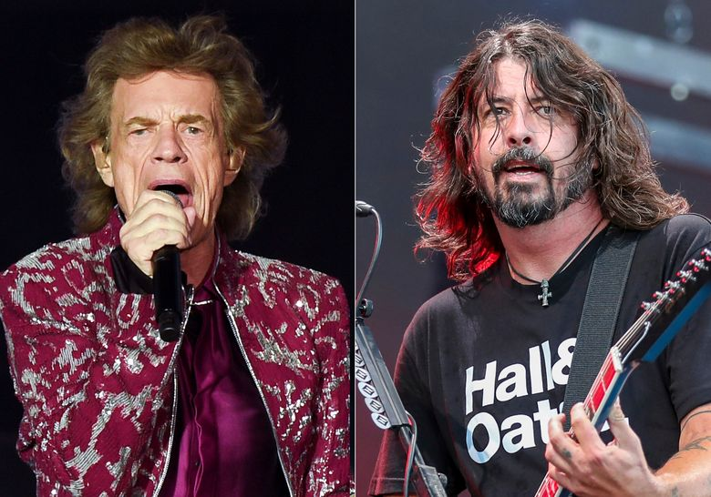 """Musician Mick Jagger of The Rolling Stones performs in East Rutherford, N.J. on Aug. 1, 2019, left, Dave Grohl of the Foo Fighters performs at Pilgrimage Music and Cultural Festival in Franklin, Tenn. on Sept. 22, 2019. Jagger and Grohl have teamed up for a hard-rock pandemic anthem called """"Eazy Sleazy."""" The duo recorded the song in different studio locations and the lyrics mention """"prison walls,"""" """"virtual premieres,"""" numbers that are """"grim"""" and Zoom calls. (AP Photo)"""