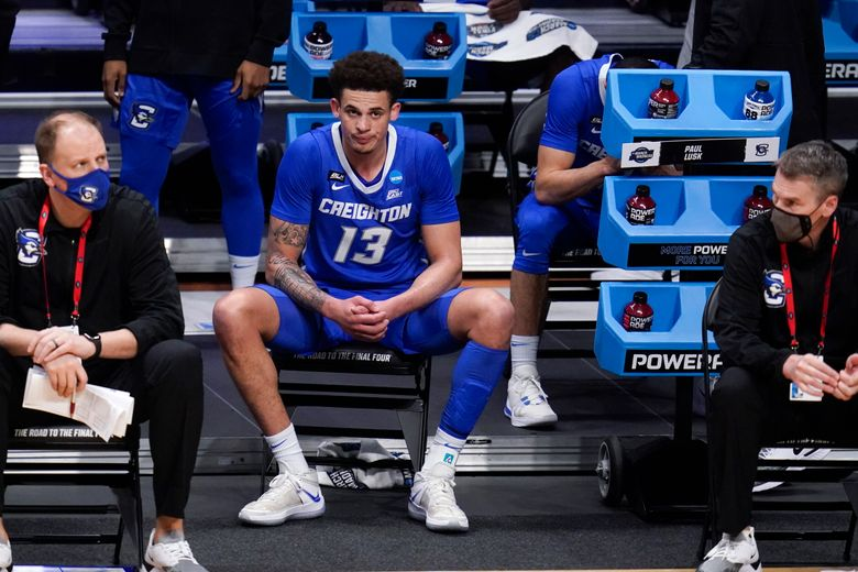 Creighton forward Christian Bishop (13) watches from the bench against Gonzaga in the second half of a Sweet 16 game in the NCAA men's college basketball tournament at Hinkle Fieldhouse in Indianapolis, Sunday, March 28, 2021. (AP Photo/Michael Conroy)
