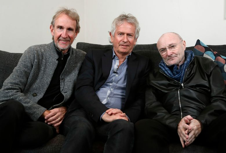 FILE – In this March 4, 2020 file photo, Genesis band members from left, Mike Rutherford, Tony Banks, and Phil Collins pose for a photo during an interview in London. The English rock band is returning to the U.S. for their first tour in 14 years. The trio announced The Last Domino? Tour on Thursday, April 29, 2021, which will kick off in Chicago on Nov. 15.  (AP Photo/Frank Augstein, File)