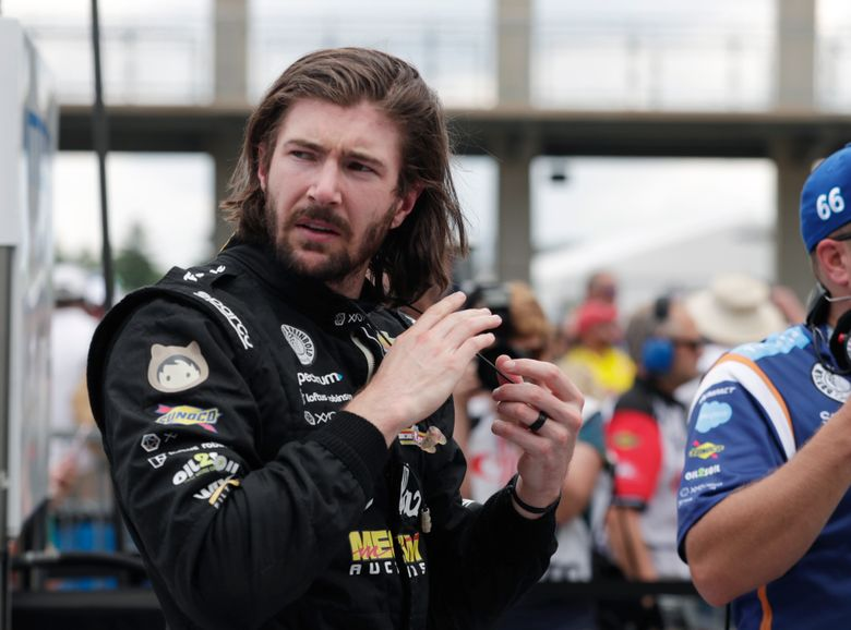 FILE – JR Hildebrand is shown in the pit area during qualifications for the IndyCar Indianapolis 500 auto race at Indianapolis Motor Speedway in Indianapolis, in this Saturday, May 19, 2018, file photo. Hildebrand has a new team and an old-fashioned look for this year's Indianapolis 500. On Thursday, April 8, 2021, A.J. Foyt Racing announced it had hired the California native to drive the No. 1 ABC Supply Chevrolet as the team's fourth driver in IndyCar's biggest race. (AP Photo/Michael Conroy, File)