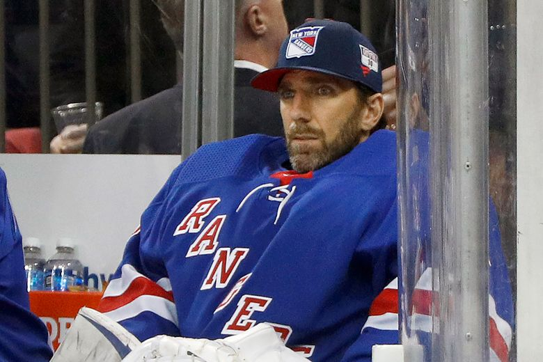 FILE – Then-New York Rangers goaltender Henrik Lundqvist looks on from the bench during an NHL hockey game against the Buffalo Sabres in New York, in this Friday, Feb. 7, 2020, file photo. Henrik Lundqvist is abandoning a long-shot attempt to return from open-heart surgery in time to play for the Washington Capitals this season after a checkup last week showed some inflammation. Lundqvist tweeted Sunday, April 11, 2021, that the inflammation around his heart requires a few months of rest and recovery. The 39-year-old goaltender had set the goal for himself of trying to join the Capitals before the end of the season. (AP Photo/Jim McIsaac, File)
