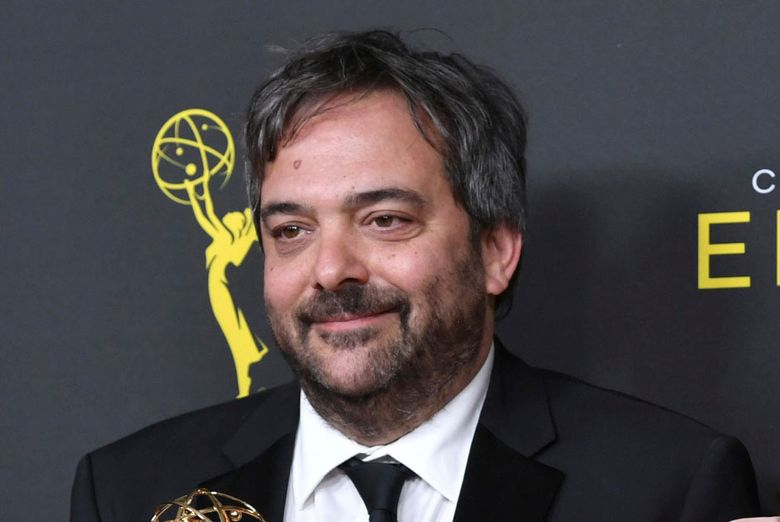 """FILE – Adam Schlesinger, winner of the awards for outstanding original music and lyrics for """"Crazy Ex Girlfriend,"""" in the press room at the Creative Arts Emmy Awards in Los Angeles on Sept. 14, 2019. An eclectic lineup of musicians is turning out for an online tribute to Adam Schlesinger, the prolific songwriter who died a year ago of COVID-19. Members of the Monkees, R.E.M., Dashboard Confessional and the Black Keys are expected, along with Sean Ono Lennon, Courtney Love, Drew Carey and Rachel Bloom. The 'musical celebration' will premiere May 5 on the Rolling Live platform. (Photo by Richard Shotwell/Invision/AP, File)"""