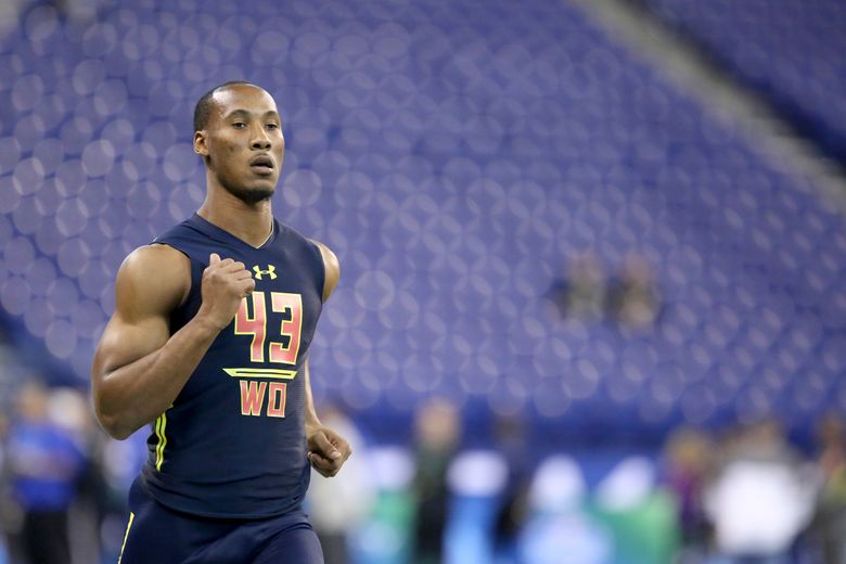 FILE – Florida State wide receiver Travis Rudolph runs a drill at the 2017 NFL football scouting combine in Indianapolis, in this Saturday, March 4, 2017, file photo. Former Florida State star football player Travis Rudolph was arrested early Wednesday, morning, April 7, 2021,  in South Florida for a shooting that left one man dead and another wounded, authorities said. Rudolph, 25, was charged with first-degree murder and attempted first-degree murder, according to a Palm Beach County Sheriff's Office news release. (AP Photo/Gregory Payan, File)