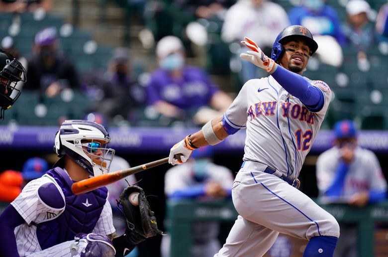 FILE – In this  Sunday, April 18, 2021 file photo, New York Mets' Francisco Lindor grounds out against Colorado Rockies starting pitcher Antonio Senzatela in the first inning of a baseball game in Denver. Francisco Lindor's contract negotiations with the Mets seemed pretty smooth. His swing certainly has not. The $341 million star shortstop entered Wednesday, April 28, 2021  batting .212 with three RBIs through 18 games with his new team and started hearing boos Tuesday night at Citi Field after grounding out late in a 2-1 loss to Boston.  (AP Photo/David Zalubowski, File)