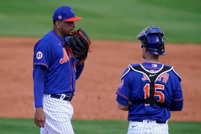 New York Mets reliever Dellin Betances, left, talks with catcher Caleb Joseph (15) as he comes in to pitch during the fifth inning of a spring training baseball game against the Miami Marlins, Friday, March 12, 2021, in Port St. Lucie, Fla. (AP Photo/Lynne Sladky)