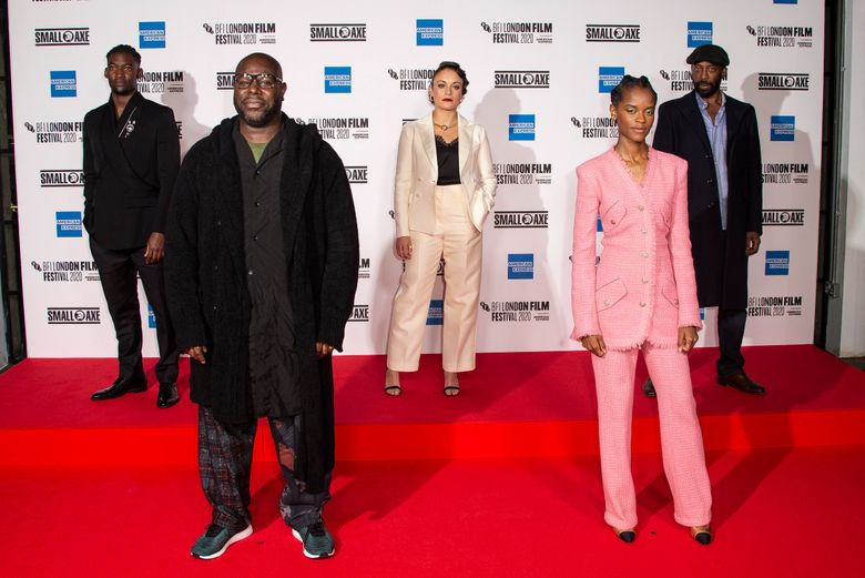 """FILE – In this Wednesday, Oct. 7, 2020 file photo, from left, actor Malachi Kirby, Director Steve McQueen, Rochenda Sandall, Letitia Wright and Shaun Parkes pose for photographers during the photo call for the film 'Mangrove', as part of London Film Festival at the BFI Southbank, in central London.  Small Axe,"""" a series of dramas exploring the experiences of London's West Indian community from the 1960s to the 1980s, received 15 nominations on Wednesday, April 28, 2021 for the British Academy Television Awards. (Photo by Joel C Ryan/Invision/AP, File)"""