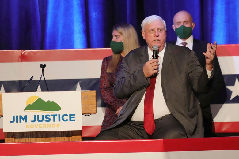 West Virginia Gov. Jim Justice signed a bill Wednesday, April 28, 2021, that bans transgender athletes from competing in female sports in middle and high schools and colleges. Above, he's shown celebrating his reelection on Nov. 3, 2020. (AP Photo/Chris Jackson, File)