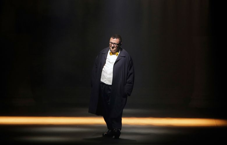 """FILE – In this file photo dated Thursday, Oct. 1, 2015, Israeli fashion designer Alber Elbaz acknowledges applause at the end of his Spring-Summer 2016 ready-to-wear fashion collection for Lanvin, presented during the Paris Fashion Week, in Paris. Elbaz, best known for being at the helm of Lanvin from 2001 to 2015, has died at the age of 59, luxury conglomerate Richemont said. Fashion French daily Women's Wear Daily said Elbaz died on Saturday, April 24, 2021 at a Paris hospital. In a statement released on Sunday, Richemont's chairman Johann Rupert said """"it was with shock and enormous sadness that I heard of Alber's sudden passing. Alber had a richly deserved reputation as one of the industry's brightest and most beloved figures."""" (AP Photo/Thibault Camus, File)"""