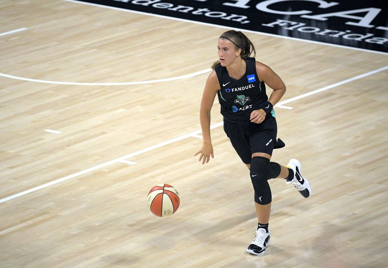 FILE – In this July 25, 2020, file photo, New York Liberty guard Sabrina Ionescu brings the ball up during the second half of the team's WNBA basketball game against the Seattle Storm in Bradenton, Fla. Ionescu is excited to be playing basketball again nearly eight months after spraining her ankle early in her rookie season with the Liberty. (AP Photo/Phelan M. Ebenhack, File)