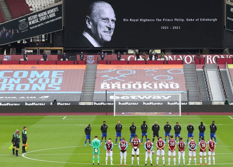 West Ham United and Leicester City players observe a two minute's silence in memory of the Prince Philip, following the announcement of his death at the age of 99, ahead of the English Premier League soccer match between West Ham United and Leicester City at the London Stadium in London, Sunday, April 11, 2021. (Julian Finney/Pool via AP)