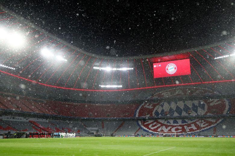 Snow falls over the stadium before the Champions League quarterfinal soccer match between Bayern Munich and Paris Saint Germain in Munich, Germany, Wednesday, April 7, 2021. (AP Photo/Matthias Schrader)