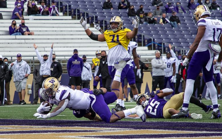 Richard Newton gets into the end zone for a touchdown Saturday.  Washington's Spring Football Game was played before about 9,000 people Saturday, May 1, 2021 at Husky Stadium in Seattle, WA. 217000 (Dean Rutz / The Seattle Times)