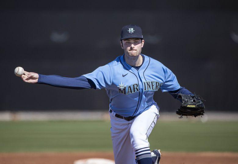 Pitcher Wyatt Mills throws during spring training last year. (Dean Rutz / The Seattle Times)