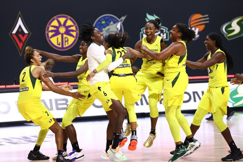 The Seattle Storm celebrates after defeating the Las Vegas Aces and winning the 2020 WNBA championship in Game 3  of the WNBA Finals against the Las Vegas Aces on October 6, 2020,  at Feld Entertainment Center in Palmetto, Florida.  (Ned Dishman / NBAE via Getty Images)