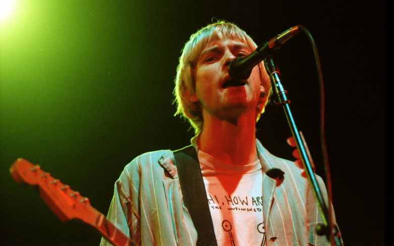 Nirvana's Kurt Cobain plays the Seattle Coliseum in 1992. His death, in 1994, was ruled a suicide. (Benjamin Benschneider / The Seattle Times, file)