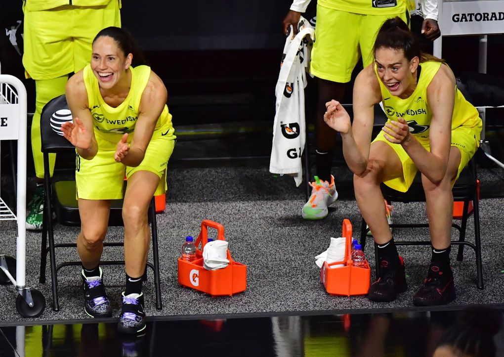 Sue Bird #10 and Breanna Stewart #30 celebrate a three point basket by Sami Whitcomb of the Seattle Storm during the fourth quarter of Game Three of their Third Round playoff against the Minnesota Lynx at Feld Entertainment Center on September 27, 2020 in Palmetto, Florida. (Julio Aguilar / Getty Images)