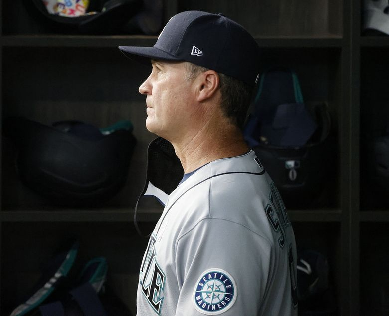 Seattle Mariners manager Scott Servais watches from the dugout as they played the Texas Rangers during the fourth inning of a baseball game Sunday, May 9, 2021, in Arlington, Texas. (AP Photo/Michael Ainsworth)