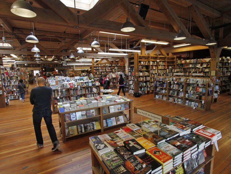 There are plenty of great books at Elliott Bay Book Co., pictured here, and other local independent bookstores to help fill your Summer Book Bingo card. (Greg Gilbert / The Seattle Times)