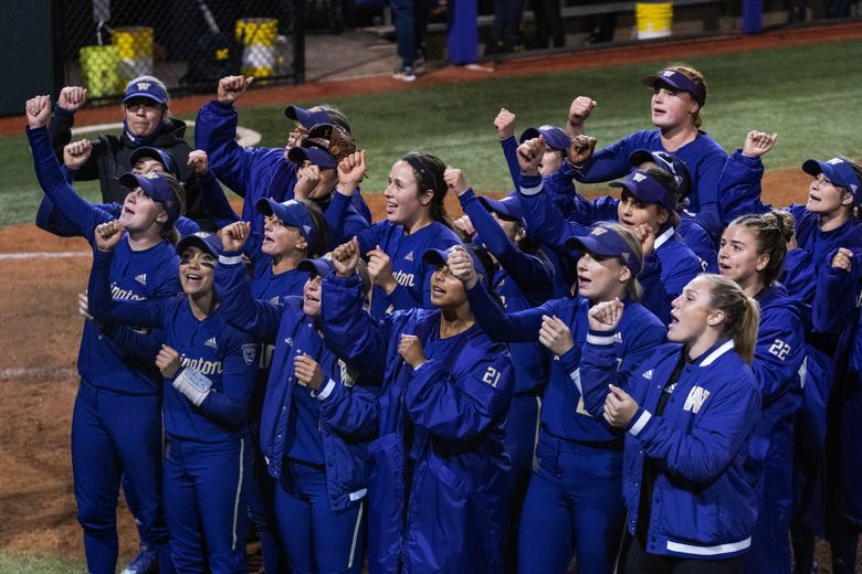 Washington does the Husky Fight Song for their fans after defeating Michigan 10-5 in the NCAA Regional Final.  The Michigan Wolverines played the Washington Huskies in Regional finals play Sunday, May 23, 2021 at Husky Softball Stadium in Seattle, WA. (Dean Rutz / The Seattle Times)
