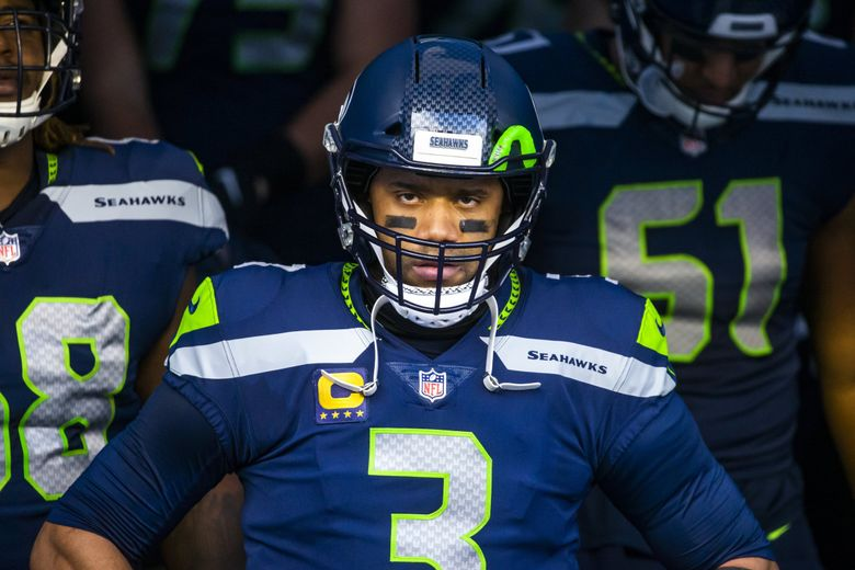 Seahawks quarterback Russell Wilson is in the zone before the Seattle Seahawks take on the Los Angeles Rams at Lumen Field in Seattle, Sunday December 27, 2020. (Bettina Hansen / The Seattle Times)