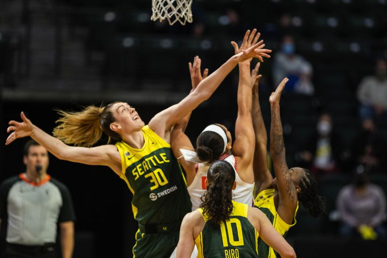 The Storm collapses on Connecticut's Brionna Jones in overtime, with Breanna Stewart, Sue Bird and Jewell Loyd triple teaming in the low post.  The Connecticut Sun played the Seattle Storm in WNBA action Tuesday, May 25, 2021 at Angel of the Winds Arena in Everett, WA.  (Dean Rutz / The Seattle Times)