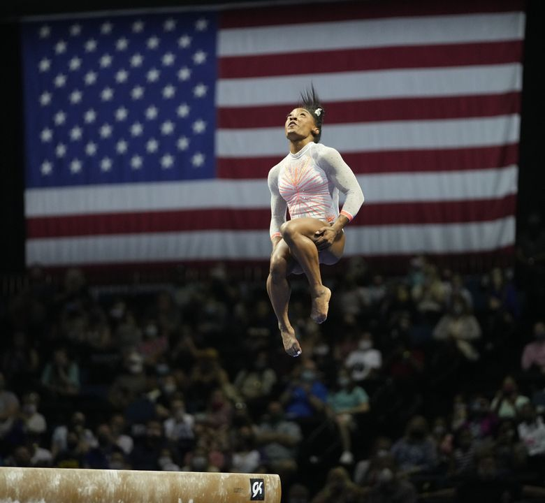Simone Biles performs her balance beam routine during the U.S. Classic gymnastics competition in Indianapolis, Saturday, May 22, 2021. (AJ Mast / The Associated Press)