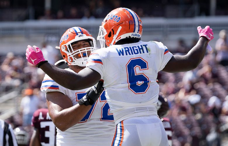 Florida running back Nay'Quan Wright (6) reacts with teammate Stone Forsythe (72) after a short touchdown run against Texas A&M during the second quarter of an NCAA college football game, Saturday, Oct. 10, 2020. in College Station, Texas. (AP Photo/Sam Craft)