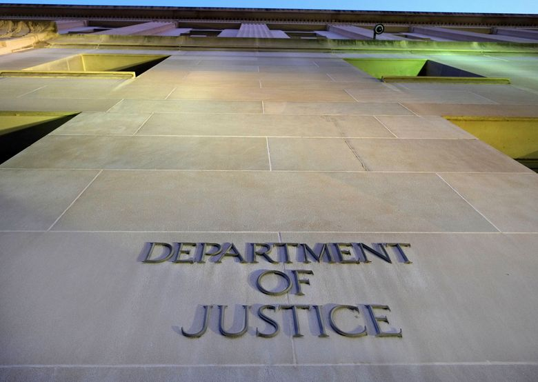 FILE – In this May 14, 2013, file photo, the Department of Justice headquarters building in Washington is photographed early in the morning. CNN says the Trump administration Justice Department secretly obtained the 2017 phone records of CNN correspondent Barbara Starr. (AP Photo/J. David Ake, File)