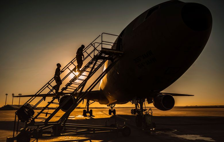 """In this Jan. 5, 2021 photo from the U.S. Air Force, two KC-10 Extender crew chiefs board the aircraft at Al-Dhafra Air Base, United Arab Emirates. An Air Force KC-10 Extender that flew out of Al-Dhafra Air Base in the United Arab Emirates on Sunday, May 2, 2021, used the call sign """"PIKLRICK"""" on a mission that saw it fly east out over the Gulf of Oman, according to flight-tracking data. The call sign appears to be a nod to an episode of the cartoon """"Rick and Morty"""" in which one of the titular characters turns himself into a pickle to escape a family therapy session. (U.S. Air Force/Staff Sgt. Trevor T. McBride, via AP)"""