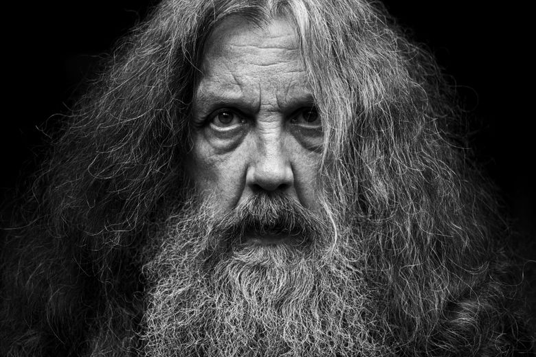 """This photo provided by Bloomsbury Publishing shows Alan Moore. The celebrated British author known for """"V for Vendetta"""" and """"Watchman"""" among other works has a deal with Bloomsbury for the story collection """"Illuminations"""" and a five-volume fantasy series, """"Long London."""" In a statement Monday, May 3, 2021, Moore said he was """"bursting with fiction, bursting with prose"""" and thanked his publisher for its commitment to """"expanding the empire of the word.""""   (Bloomsbury Publishing/Mitch Jenkins via AP)"""