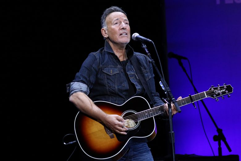 FILE – Bruce Springsteen performs at the 13th annual Stand Up For Heroes benefit concert in support of the Bob Woodruff Foundation in New York on Nov. 4, 2019. Springsteen is this year's winner of the Woody Guthrie Prize. The award honors artists of any medium who continue the legacy of the Oklahoma songwriter. Springsteen calls Guthrie one of his most important influences. The legendary performer will be honored in a virtual ceremony May 13.  (Photo by Greg Allen/Invision/AP, File)