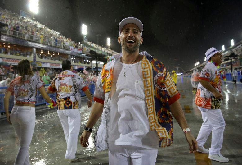 Comedian and actor Paulo Gustavo participates in the Carnival parade at the Sambadrome in Rio de Janeiro, Brazil, in 2015. Gustavo, 42, died of COVID-19 in a Rio hospital on Tuesday, May 4, 2021. (AP Photo/Bruna Prado, File)