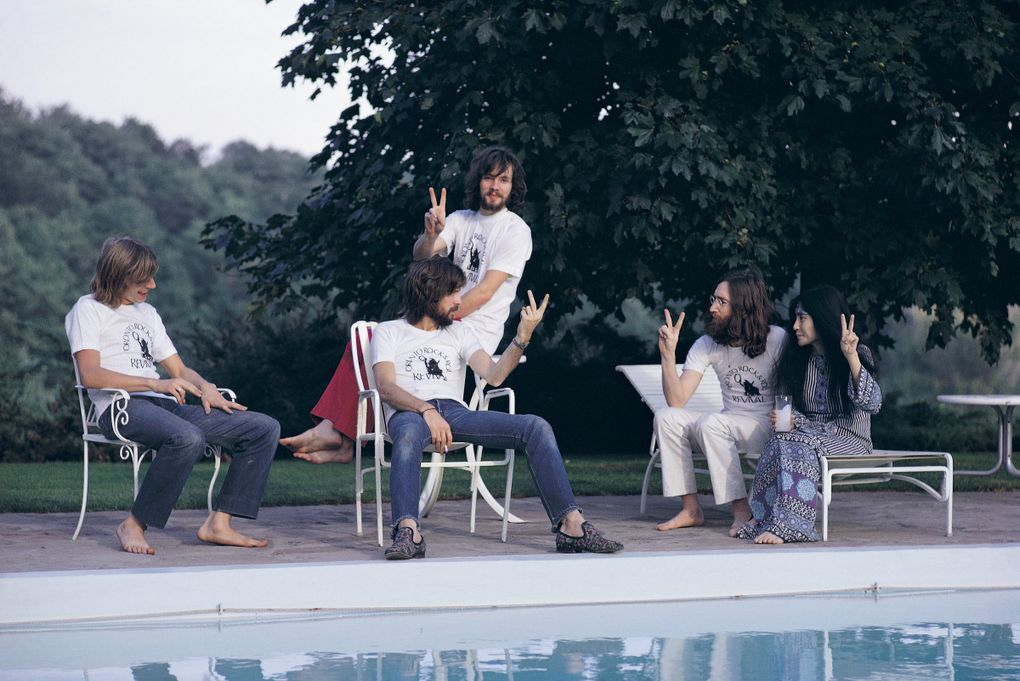 Left to right: Drummer Alan White, Eric Clapton (seated), bassist Klaus Voormann, John Lennon and Yoko Ono the day after the Plastic Ono Band headlined the Toronto Rock and Roll Revival show at Varsity Stadium, Toronto, September 1969. (Mark and Colleen Hayward / Getty Images)