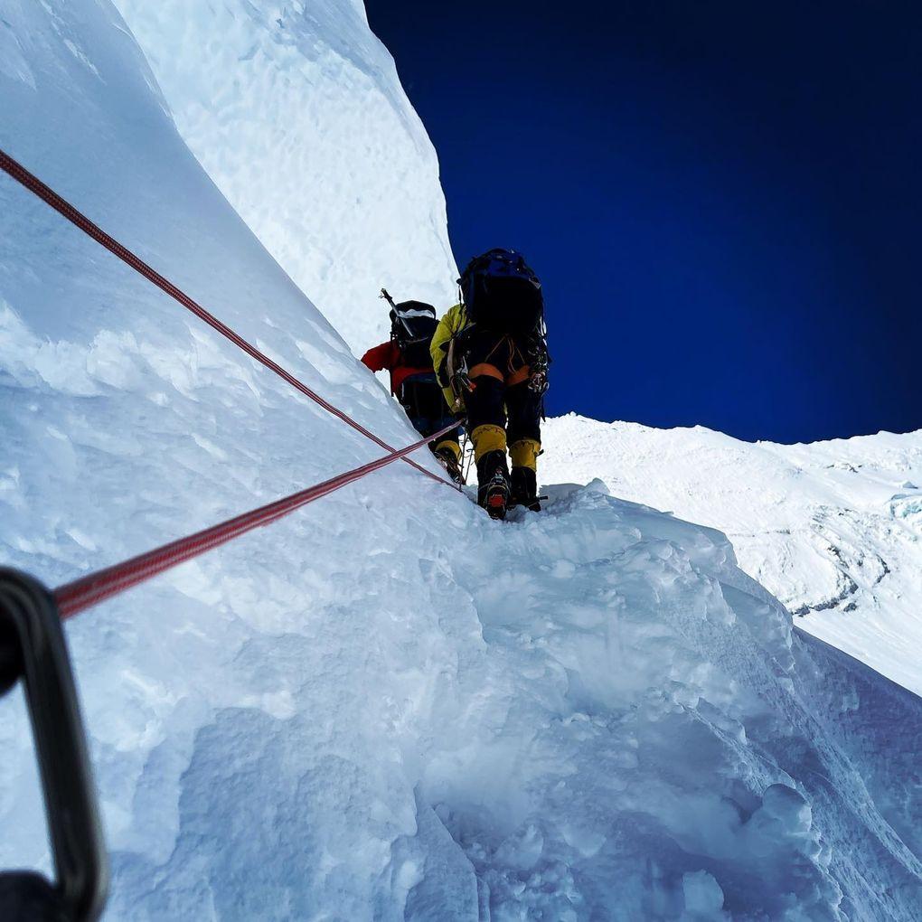 Mark Pattison climbs a snow bank on Mount Everest. (Courtesy of Mark Pattison)