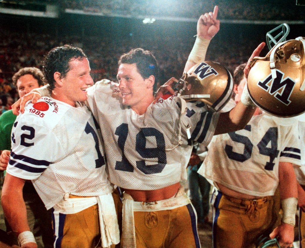 University of Washington Huskies Mark Pattison and Hugh Millen hug as the final seconds run off the clock in the 1985 Orange Bowl. (Harley Soltes / The Seattle Times)