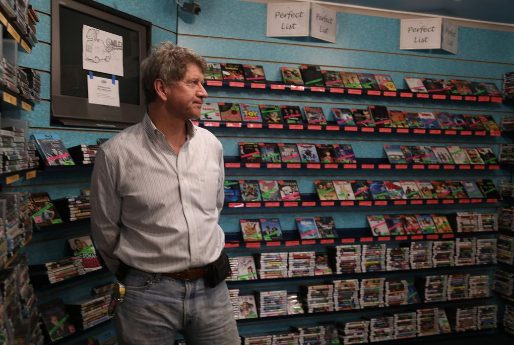 Reckless Video owner Mike Kelley and his staff organize movies in ways that make for intriguing juxtapositions in sections such as The Perfect List. (Greg Gilbert / The Seattle Times)