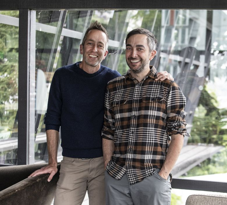 Mark Canlis, left, and brother Brian, third-generation owners of Seattle fine dining hot spot Canlis, know the value of a good read. (Steve Ringman / The Seattle Times)