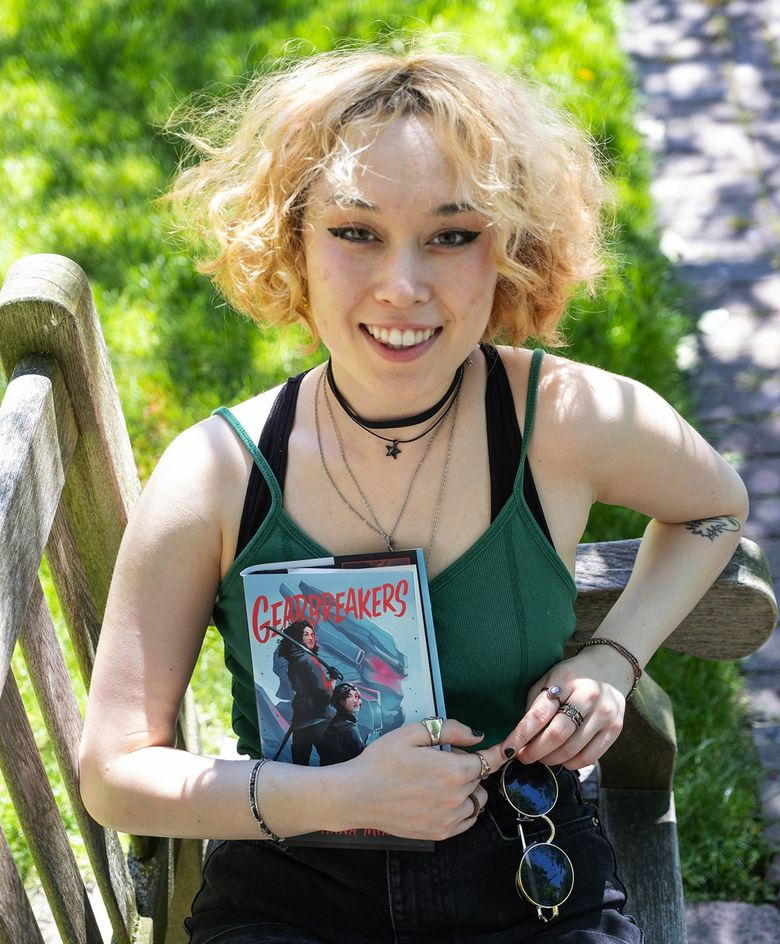 """University of Washington undergraduate Zoe Hana Mikuta is the author of """"Gearbreakers,"""" a young adult science fiction title out June 29 that has been optioned for a movie. (Dean Rutz / The Seattle Times)"""