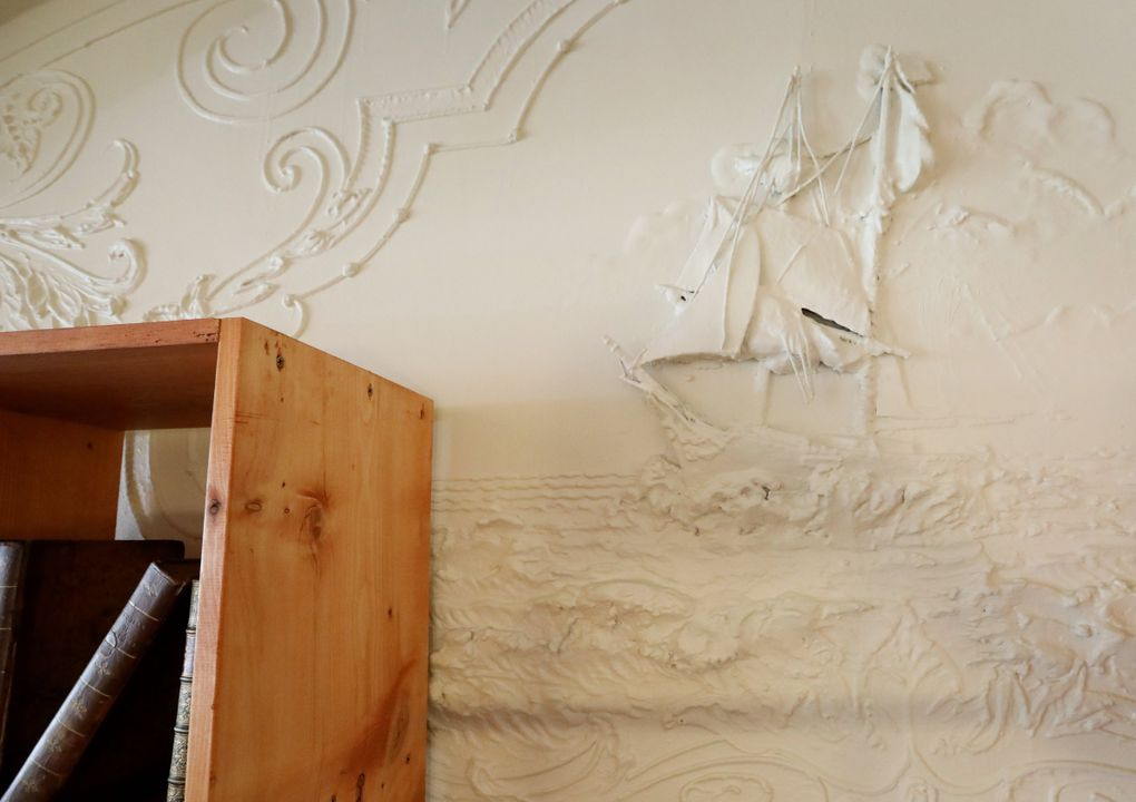 A sailing ship is seen in the historical molding at Arundel Books in Pioneer Square. A series of friezes lining the vaulted ceilings of the building that now houses the bookshop depict the immigration story of the Schmidt family, creators of Olympia Brewing Company — the space's first tenants. (Ken Lambert / The Seattle Times)