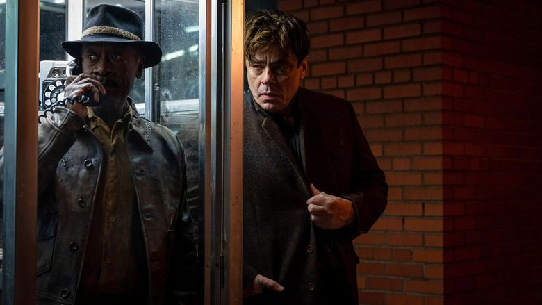 """Two small-time crooks (played by Don Cheadle, left, and Benicio Del Toro) get caught up in a conspiracy in Steven Soderbergh's """"No Sudden Move."""" (Claudette Barius / HBO Max)"""