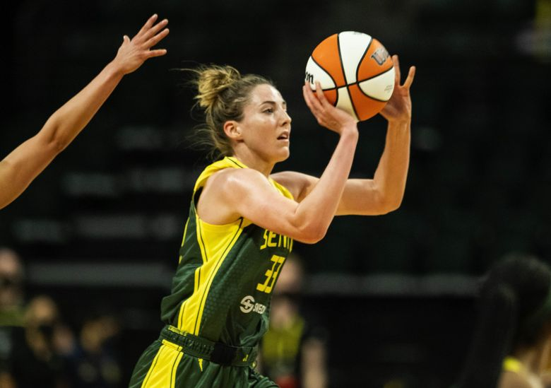 Seattle's Katie Lou Samuelson hits the shot with no time left, and from near midcourt, to end the 3rd quarter 66-62 in favor of Las Vegas.  The Las Vegas Aces played the Seattle Storm in WNBA basketball Tuesday, May 18, 2021 at Angel of the Winds Arena in Everett, WA. (Dean Rutz / The Seattle Times)