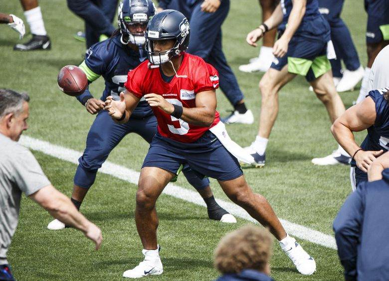 Seahawks quarterback Russell Wilson (3) warms up during OTAs on Tuesday at Virginia Mason Athletic Center. (Amanda Snyder / The Seattle Times)