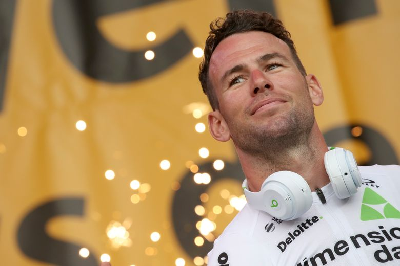 FILE – In this Thursday, July 5, 2018 file photo, Britain's sprinter Mark Cavendish listens during the Tour de France cycling race team presentation in La Roche-sur-Yon, Vendee region, France, ahead of Saturday's start of the race. Veteran sprinter Mark Cavendish will make his return to the Tour de France after a three-year absence from cycling's biggest event, his team said on Monday June 21, 2021. (AP Photo/Christophe Ena, File)