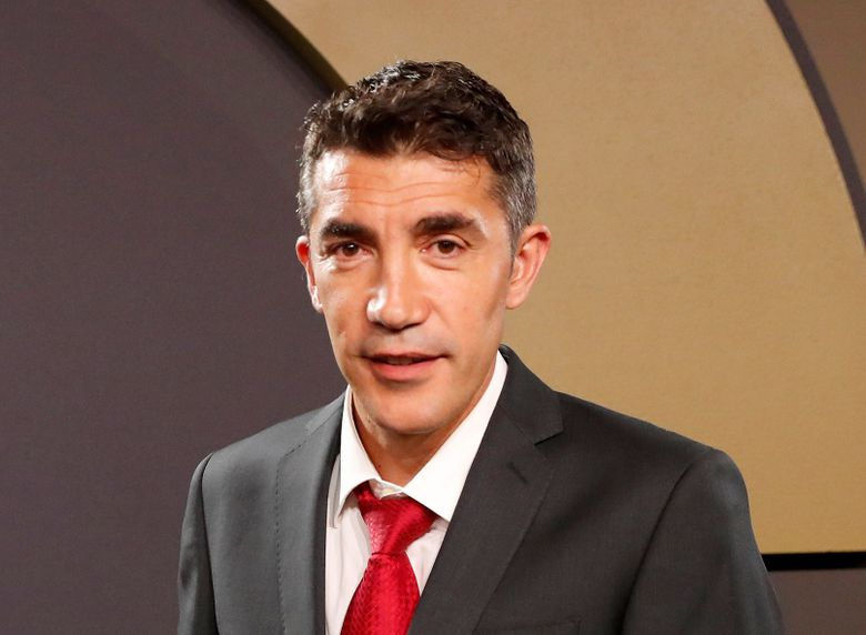 FILE – In this Monday, Sept. 2, 2019 file photo, Benfica coach Bruno Lage poses after winning his coach of the year award at the Portuguese soccer federation awards ceremony in Lisbon. Wolverhampton Wanderers has appointed former title-winning Benfica coach Bruno Lage to manage the Premier League team. It marks a return to English football after the 45-year-old Lage spent time as Carlos Carvalhal's assistant at Sheffield Wednesday and Swansea. (AP Photo/Armando Franca, File)
